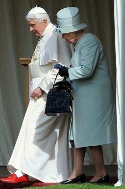 Britain's Queen Elizabeth II and Pope Benedict XVI walk through the
